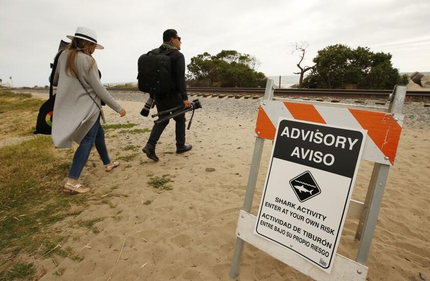 Drone photographer Carlos Gauna and his wife, Andressa, head to a beach along the Santa Barbara County coast.