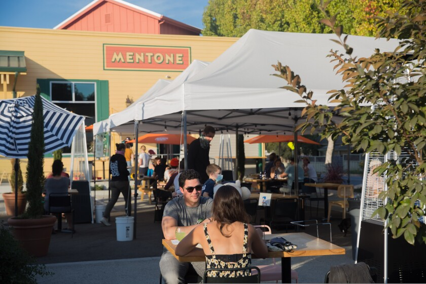 """Diners at Mentone's """"Little Beach,"""" their 15-month pizzeria takeout option"""
