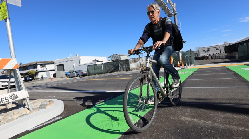 A Santa Cruz local enjoys his ride down the new trail rail path on the Westside.