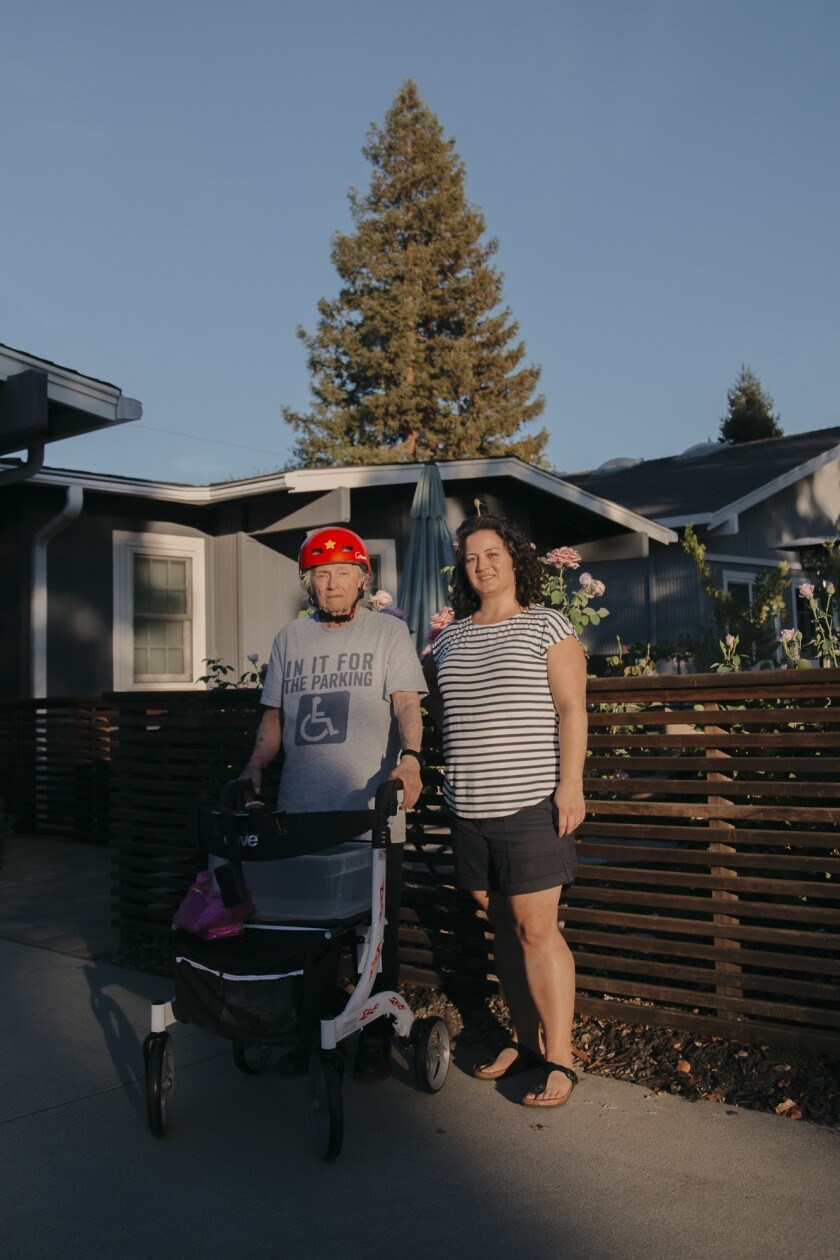 Ann Lucero and her mother Fern pose for a portrait outside of their home in Redwood City on Oct. 11, 2020. Photo by Clara Mokri