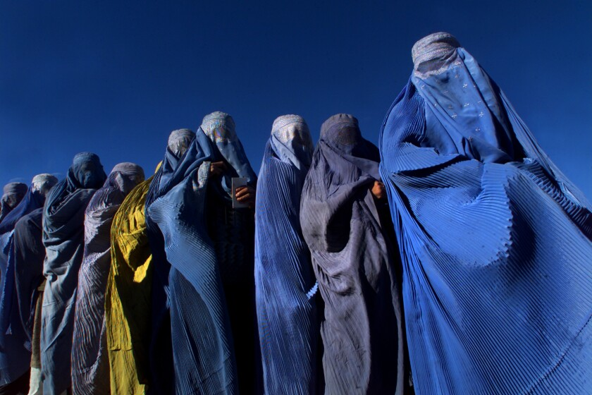 A line of women in full burqas