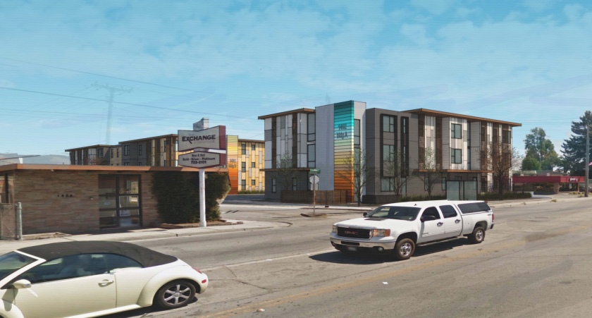 A pair of three-story buildings make up the residential development at 1482 Freedom Blvd.