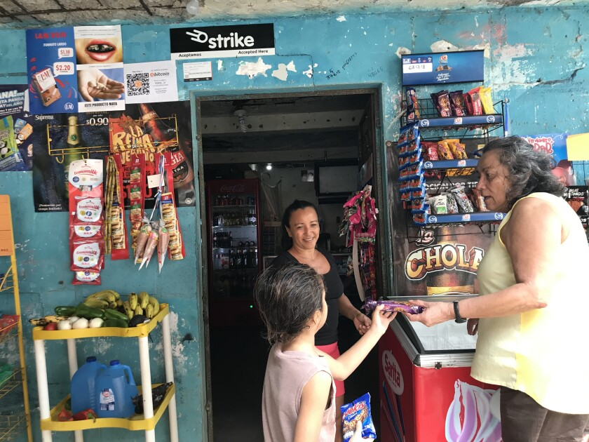 Women and a child at a shop counter