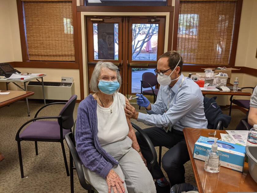 Beverly Winthers, a 95 year-old resident of Dominican Oaks, receives a first dose of the Moderna vaccines