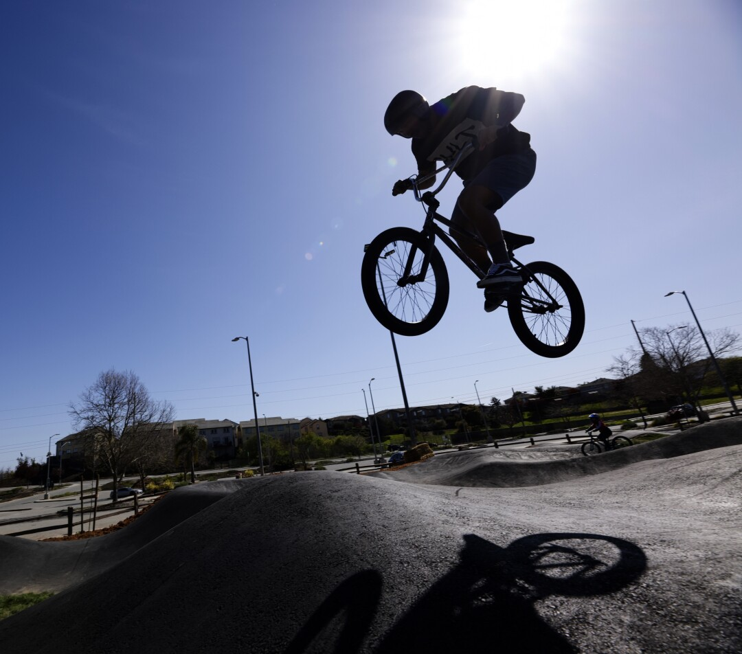 Anthony Quiroz tests out the new pump track's aerial capabilities on Tuesday