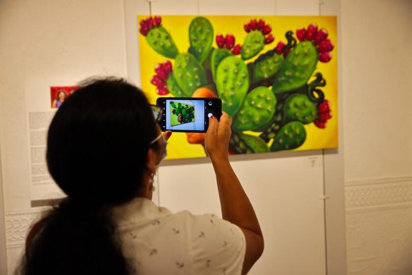 Rosa Sanchez of Watsonville takes in cactus artwork.