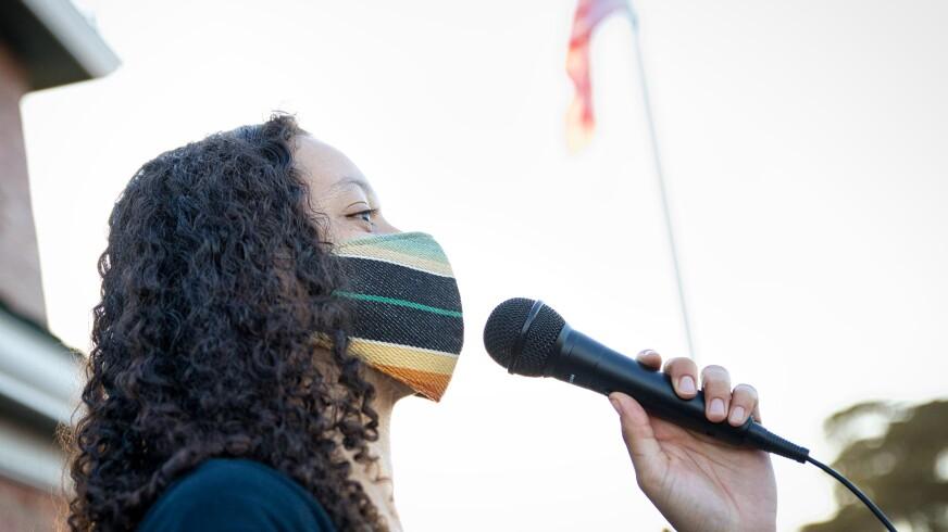 Bella Bonner addresses the masses at Lighthouse Field on June 3.