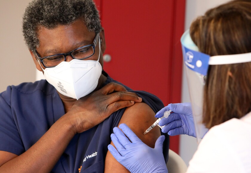 Dominican Hospital nurse Toni Luckett becomes the first person in Santa Cruz County to get vaccinated for COVID-19.