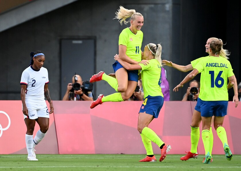 -SP- July 21, 2021: Sweden's Stina Blackstenius jumps into the arms of a teammate after scoring a goal against USA in the first half in a Group G game at the 2020 Tokyo Olympics. (Wally Skalij /Los Angeles Times)