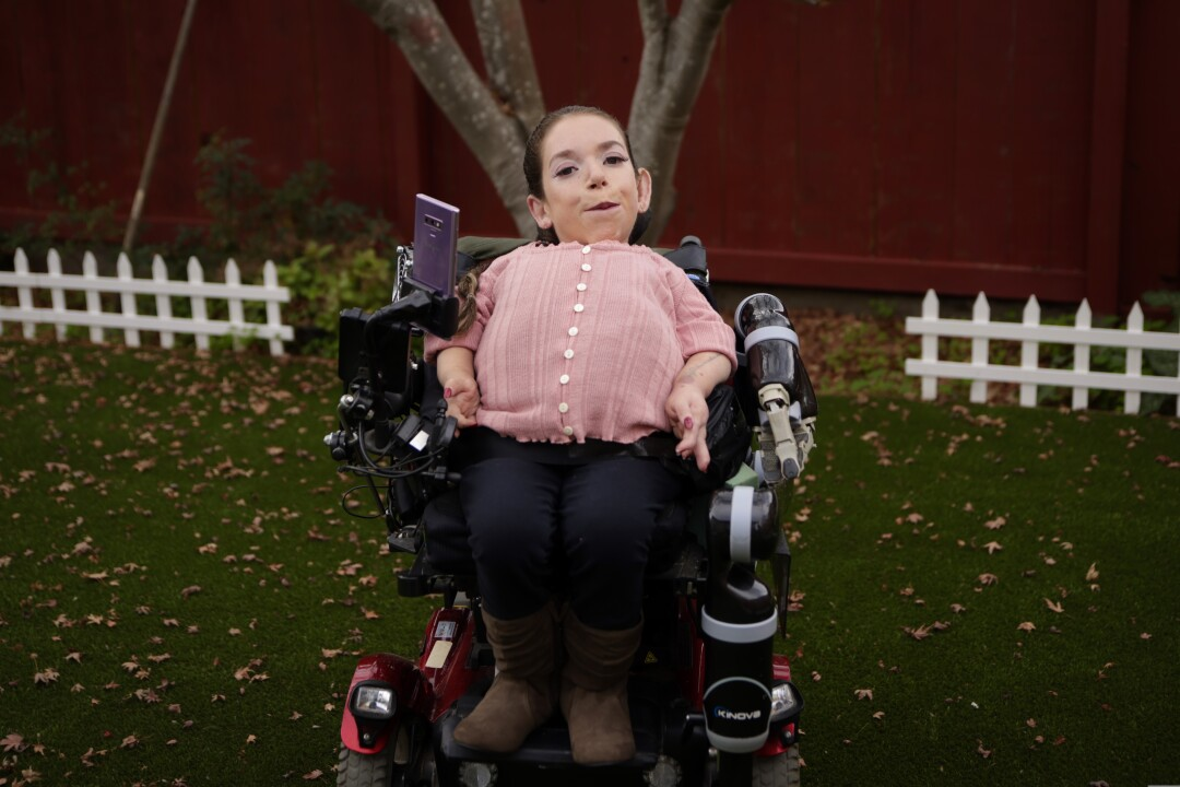 Brenda Gutierrez Baeza in her wheelchair outdoors in Santa Cruz.