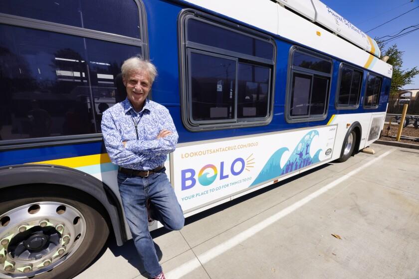Wallace Baine and a Santa Cruz Metro bus with the BOLO logo