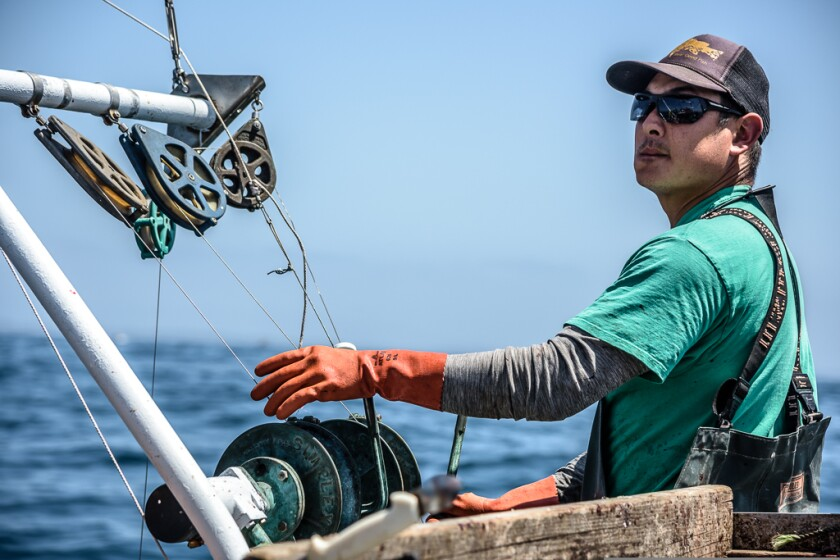 Dave Toriumi fishing on his boat in the Monterey Bay