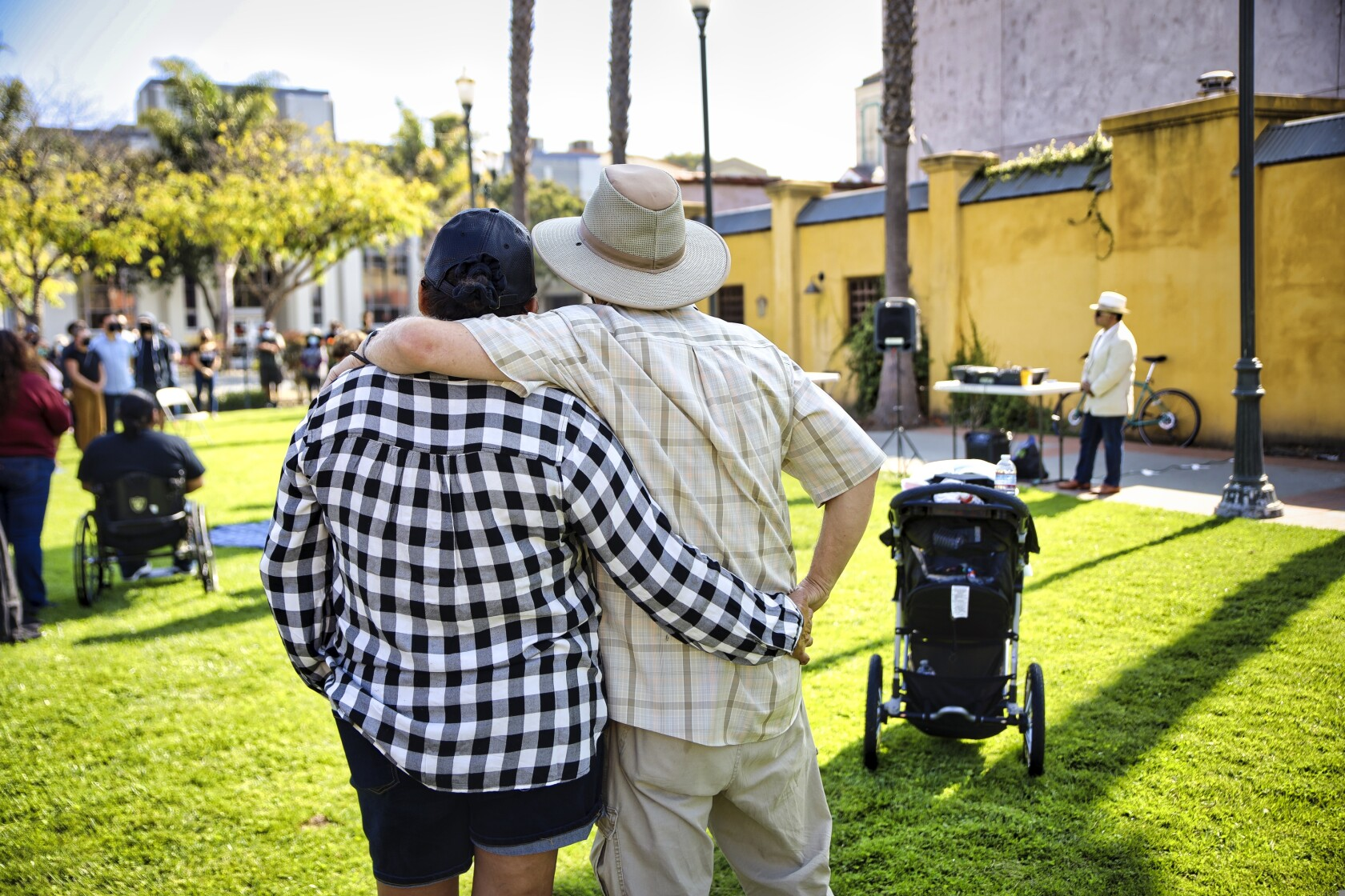 Two attendees embrace during speeches being given at the Peace and Unity Vigil held in Watsonville on Sunday Sept. 5.