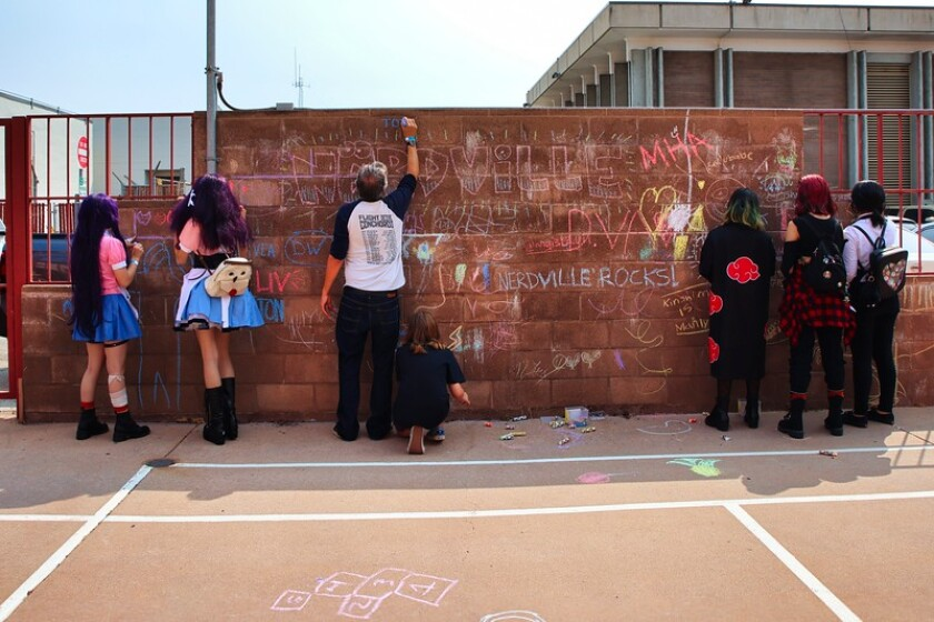 A brick wall made a perfect canvas for those who attended Nerdville to make their mark.