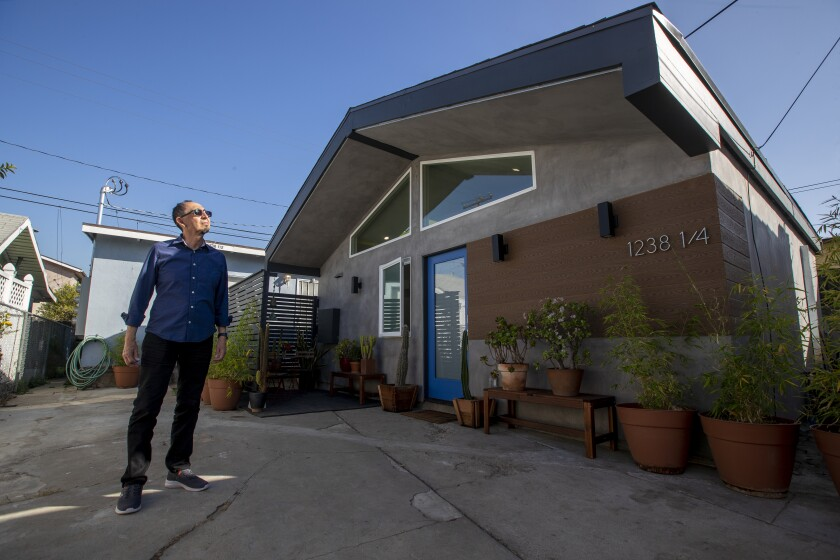 """Landlord and designer Alexis Navarro stands in front of his """"Casita L.A.,"""" a new ADU he designed in East L.A."""