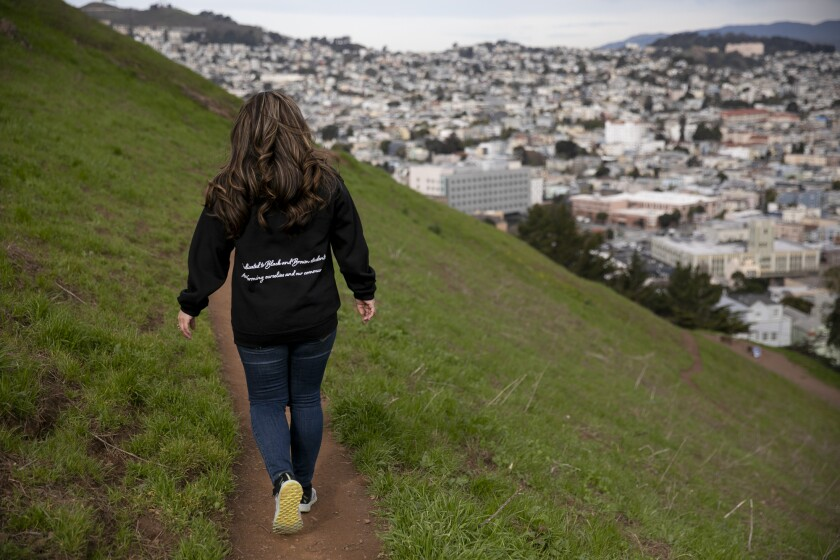 San Francisco native Veronica Garcia sits for a portrait at Bernal Heights park on Feb. 18, 2021. Garcia says when she entered San Francisco City College in 2008 she was required to take remedial classes which caused her to take more than four years before she was able to transfer to a four-year university. Photo by Anne Wernikoff, CalMatters