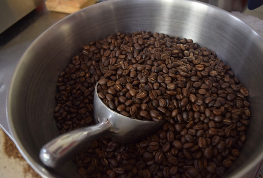 A bowl of roasted coffee beans sits inside Hidden Fortress Coffee Roasting in Watsonville.