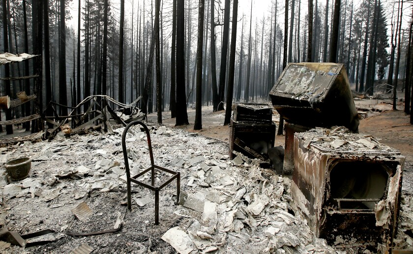 A chair frame in a burned home in the woods