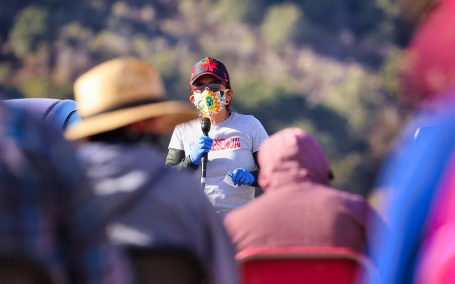 Ruby Vasquez talks to campesinos in Watsonville.