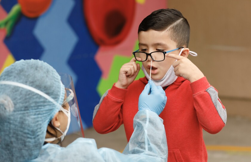 A kindergarten student gets a COVID test