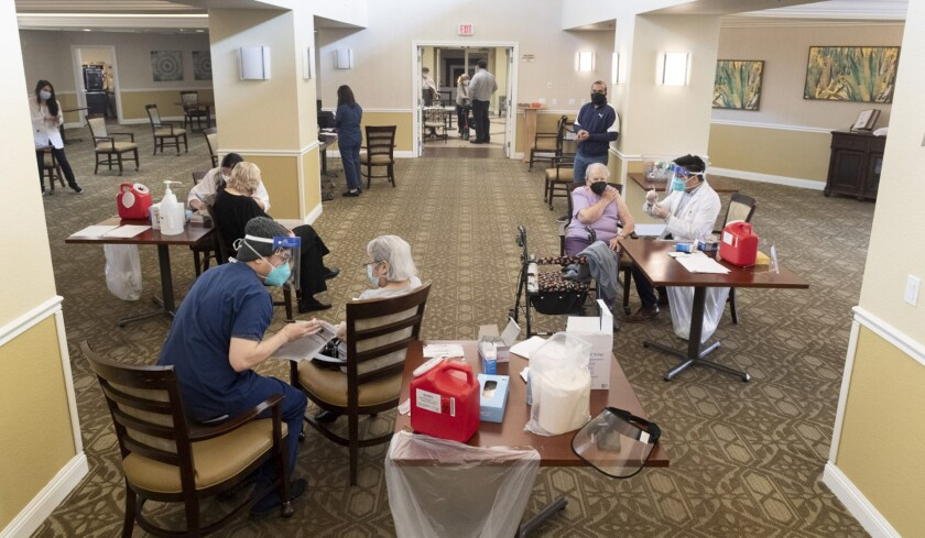 Residents get the Pfizer/BioNTech COVID-19 vaccine at the Emerald Court senior living community in Anaheim