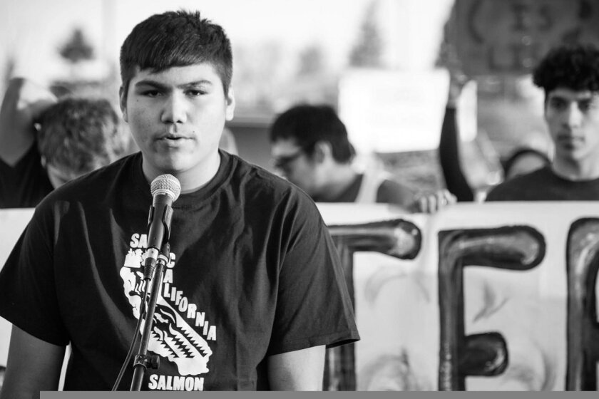 A member of the Hoopa Valley High School Water Protectors Club speaks at a 2020 rally to shut down the Delta Tunnels Project