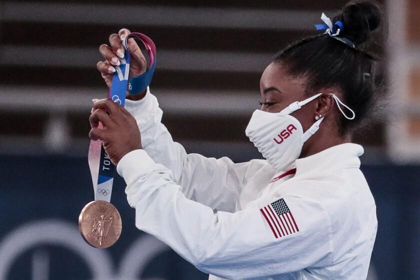 USA gymnast Simone Biles receives a Bronze Medal in the Women's Balance Beam Final at Ariake Gymnastics Centre.
