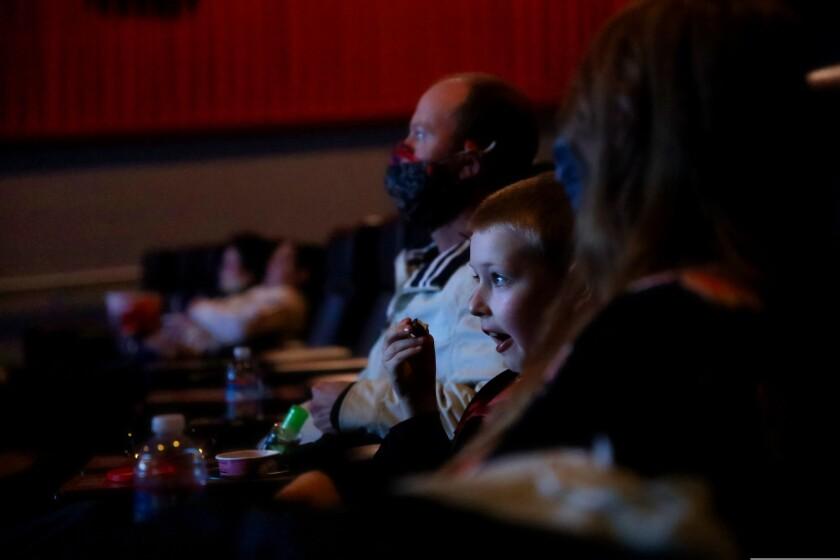 Chakra Aquarius, 8, and his parents enjoy opening night at Santa Cruz Cinema.