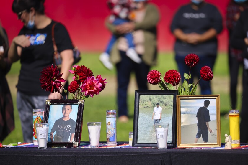 The vigil in Watsonville Sunday featured photos of the 17-year old Aptos High student.