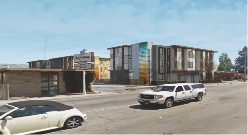 A rendering of 1482 Freedom Boulevard, with multiple housing buildings along a street with cars.