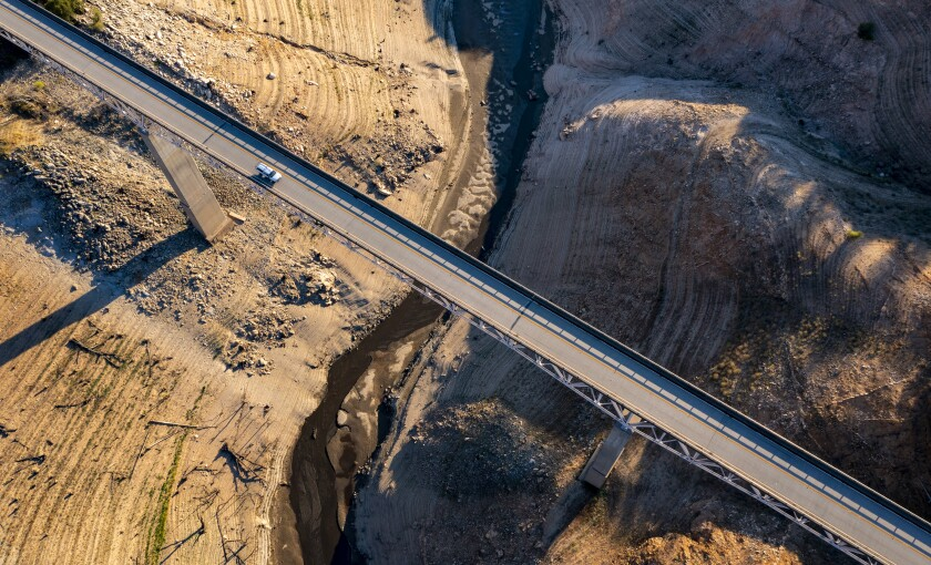A truck crosses the Enterprise Bridge at Lake Oroville, which stands at 33 percent full