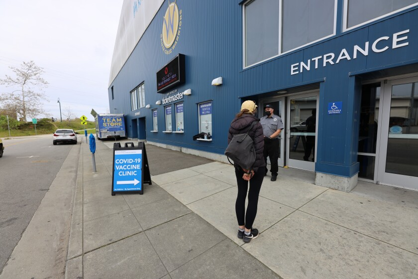 A patient waits to enter the COVID-19 vaccination clinic at the Kaiser Permanente Arena in Santa Cruz
