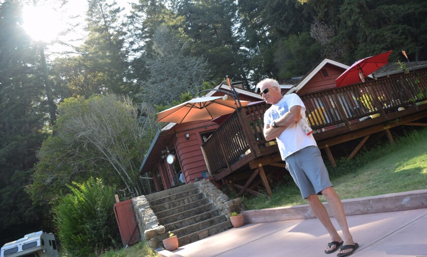 Gordon Rudy stands in front of his Boulder Creek home