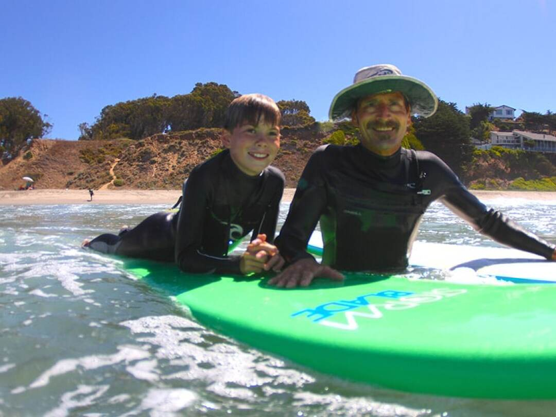 Ed Guzman has been teaching surf lessons in Santa Cruz for three decades.