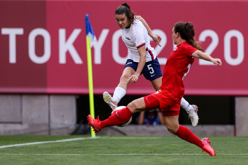U.S. defender Kelley O'Hara tries to move the ball past Canada midfielder Julia Grosso during Monday's match.