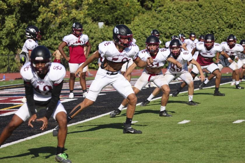 Members of the Santa Cruz High football team practice on Sept. 21, 2021.