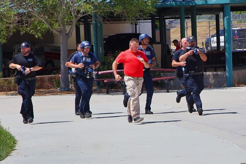 Personnel on the move during Wednesday's active shooter drill.
