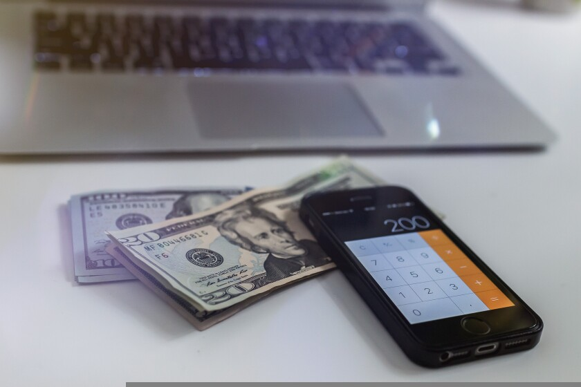 File image of money and phone calculator