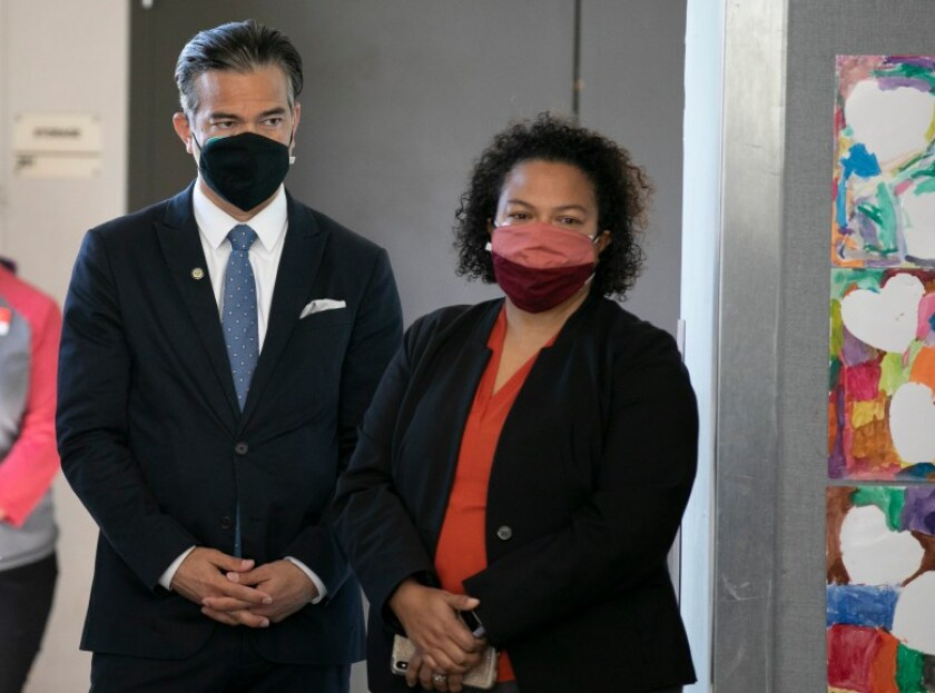 Then-Assemblymember Rob Bonta, left, and his wife, Mia Bonta, at a press conference in March shortly before he was appointed attorney general. Funds from the Bonta California Progress Foundation are now prohibited from going to any organization that employs either Bonta. Photo by Anne Wernikoff, CalMatters