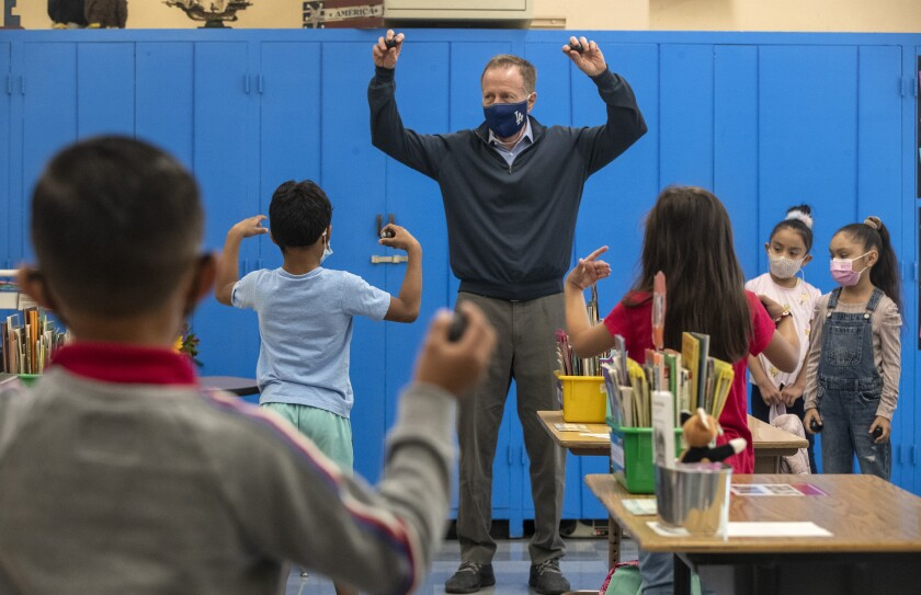 LAUSD superintendent Austin Beutner dances with Canterbury Avenue Elementary School first-graders on Tuesday, April 20, 2021