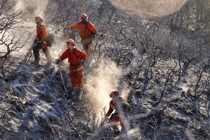 Inmate firefighters work in Boulder Creek on Jan. 20, 2021 after more than a dozen fires broke out in Santa Cruz County.
