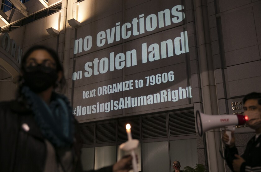 Housing activists and rent strikers participate in a vigil for tenants