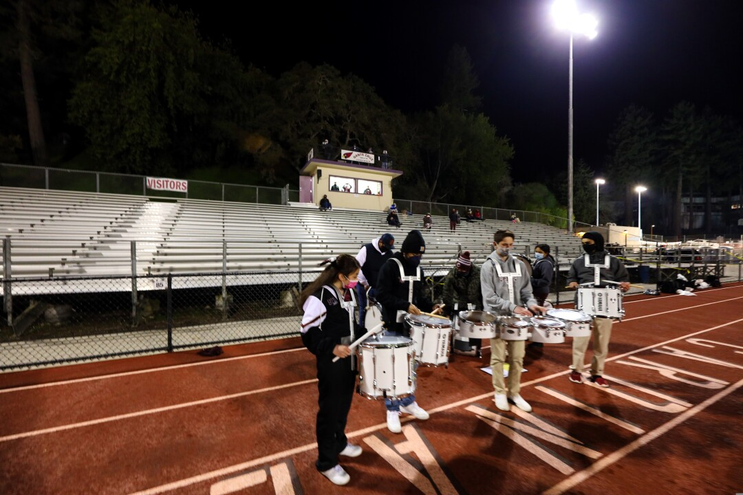 The St. Francis drummers keep a little vibe going in the otherwise-quiet stadium.