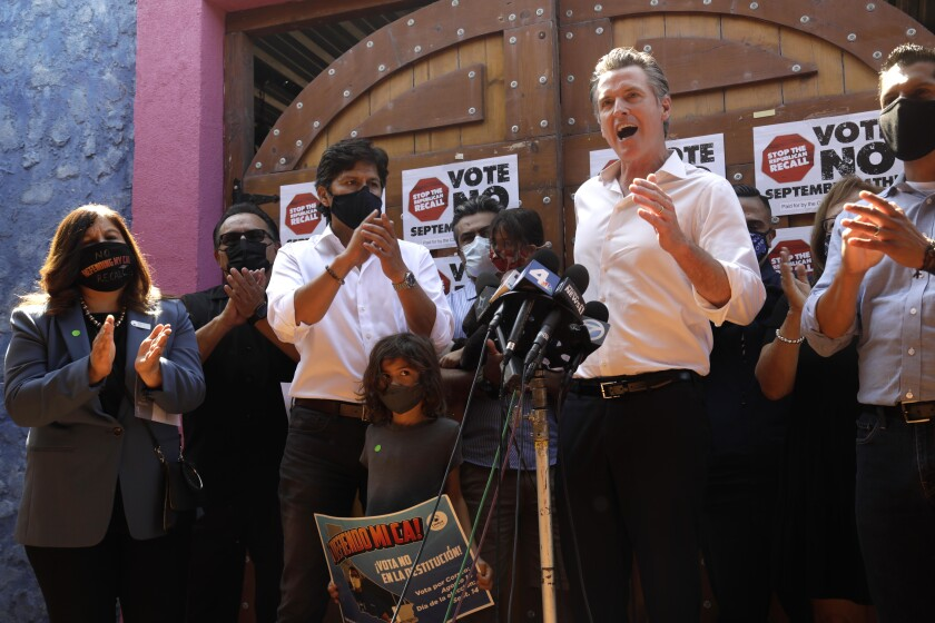 California Gov. Gavin Newsom makes a statement against his recall while meeting with Latino leaders