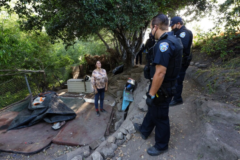 Santa Cruz police work to get occupants out of the Highway 1/9 camp on Monday.