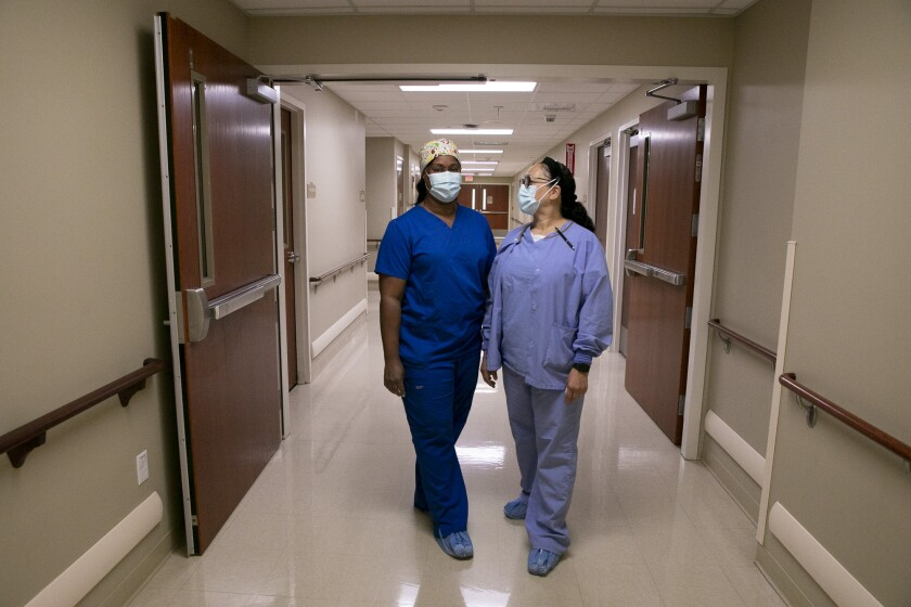Traveling nurses Candace Brim, left, and Janet Stovall, right
