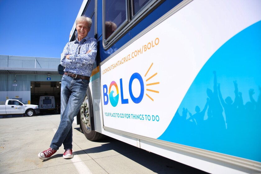 Lookout Santa Cruz's City Life Correspondent Wallace Baine with BOLO bus signs
