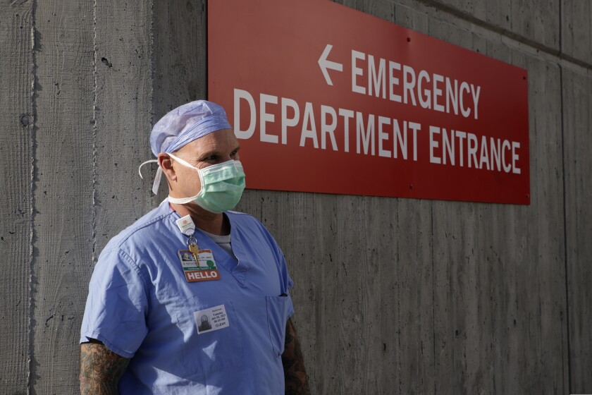 Cardiovascular specialist Danny Combs takes a breather outside the ER department at Dominican Hospital