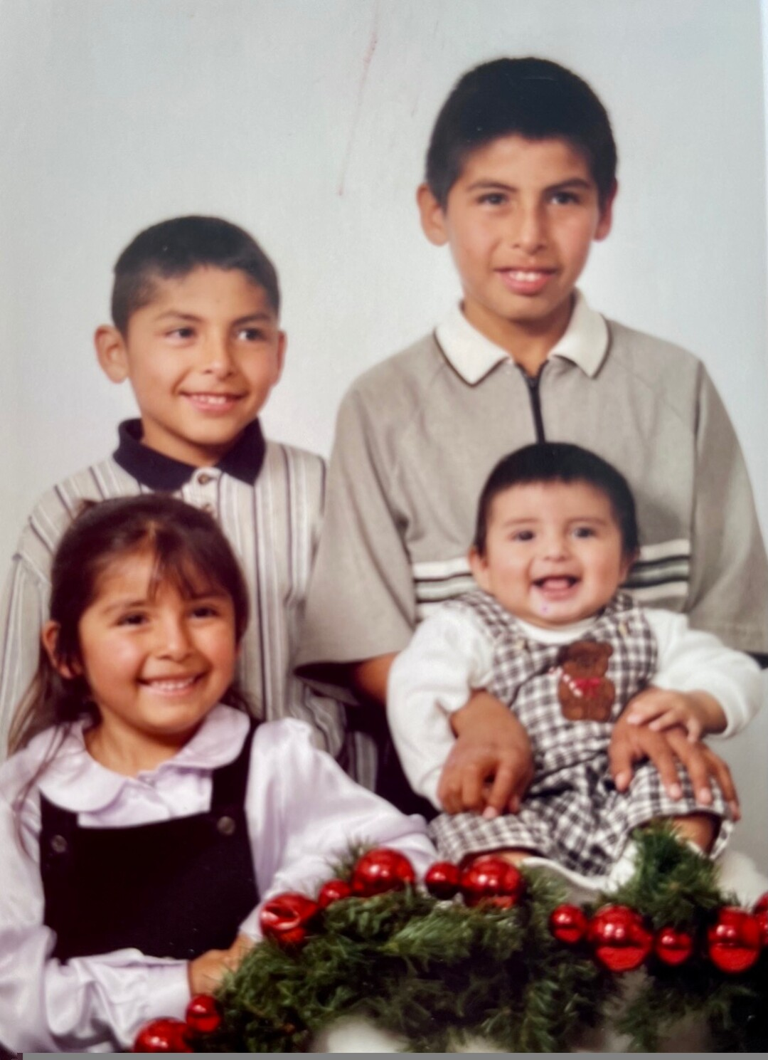 Edward, top right, holding Issac and smiling along with Veronica and David.