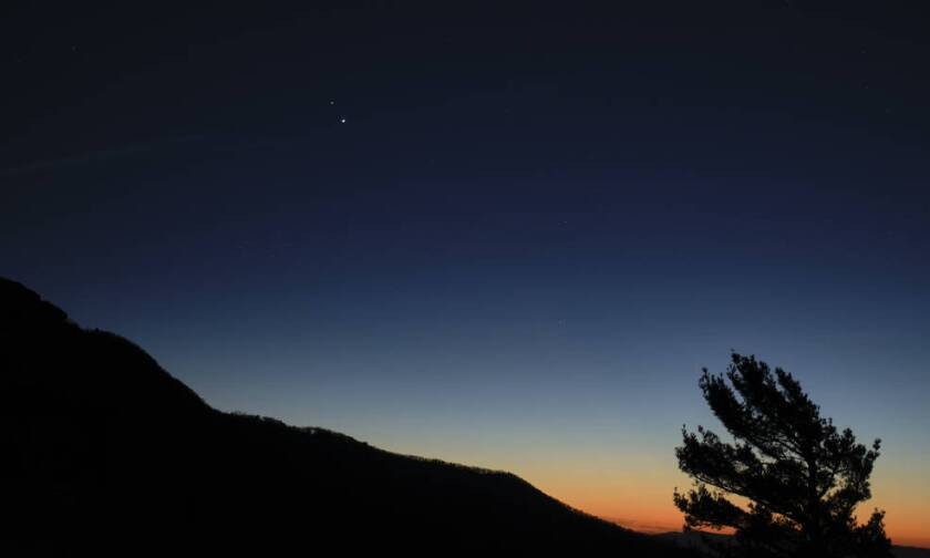 Saturn, top, and Jupiter, below, are seen after sunset from Shenandoah National Park, Sunday.